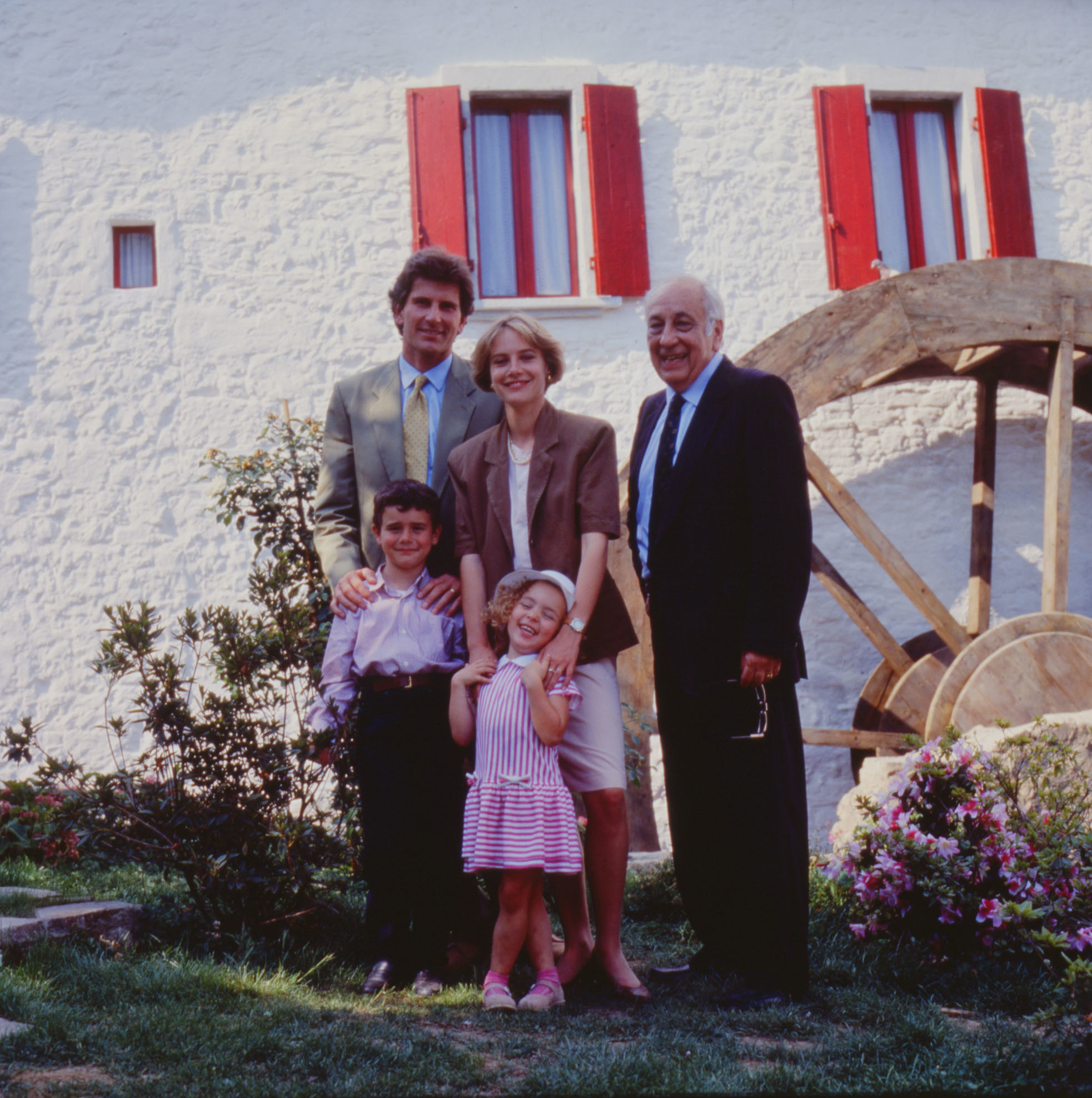 The Family of the Mill poses in front of the wheel of Chiusdino Mill during the shootings of the advertisings in 1990