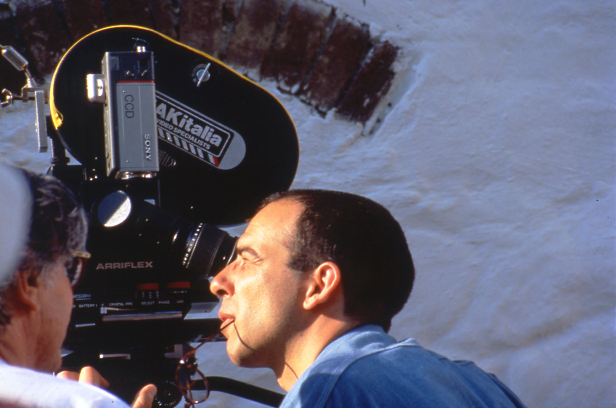 The director Giuseppe Tornatore during the shooting of the first advertisings of the Family of the Mill at Chiusdino in 1990