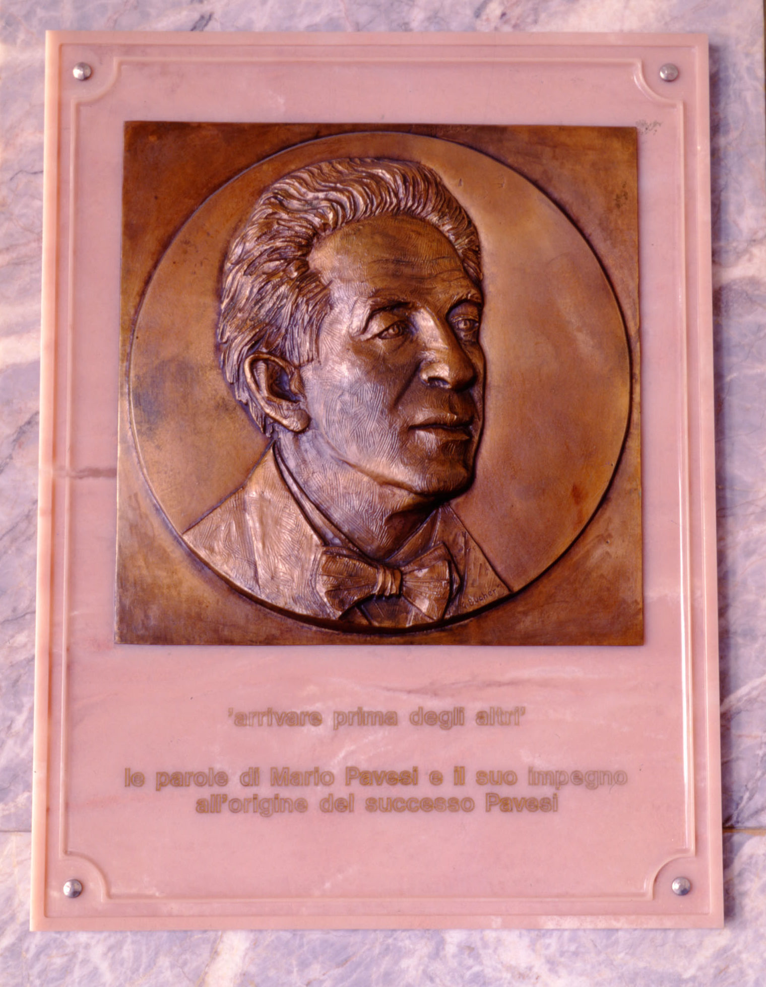 The bronze medal made by the artist Giovanni Bucher, located at Pavesi plant in Novara in 1992
